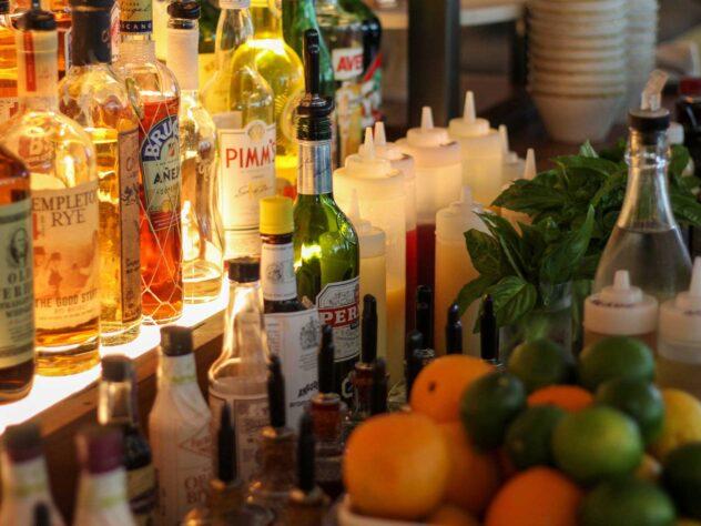 close up of cocktail and liquor mixtures at bar counter