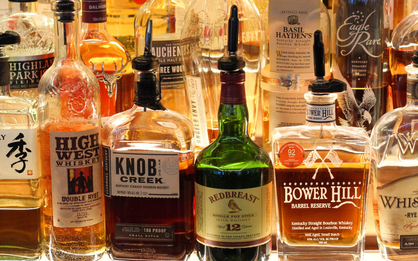Bar shelf with a large selection of whiskies